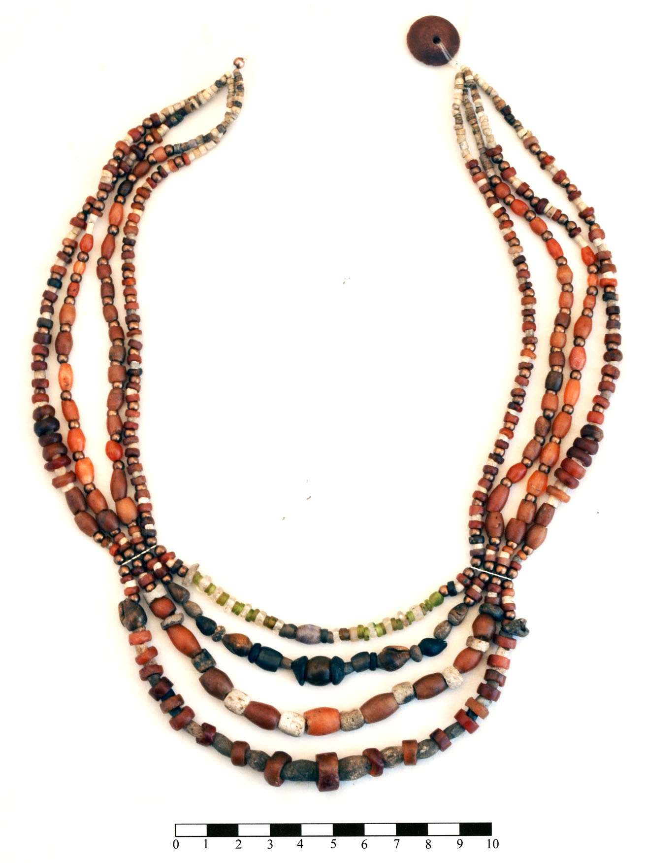 Fig. 10. The restored necklace from the so-called Palace of the Copper Axes at Khirbat al-Batrawy, with beads made of amethyst, carnelian, olivine, rock crystal, quartz, bone, frit, seashell, and copper (courtesy Khirbat al-Batrawy Excavations).