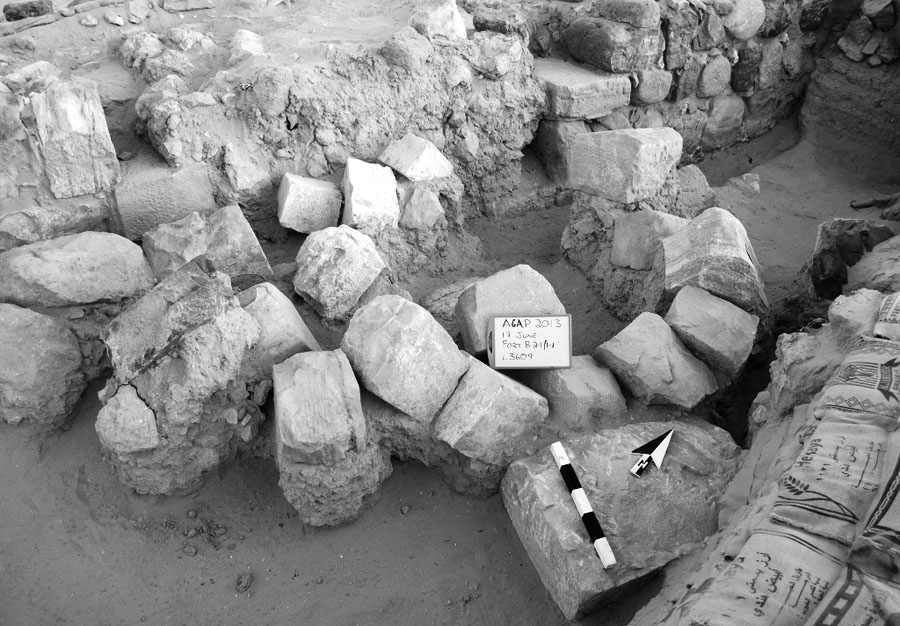 Fig. 18. Collapsed archway of the gate of the Late Roman fort at 'Ayn Gharandal, with in situ inscription block (facedown) at lower right (courtesy 'Ayn Gharandal Archaeological Project).