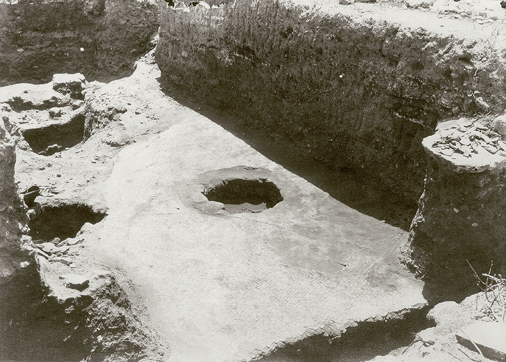 "Fig. 2. Possible tessera floor of the basilica hall at Ashkelon (PEF 359, ""Same as 135 [Interior middle of great court showing excavation from W], showing original tessellated pavement,"" 1921; courtesy Palestine Exploration Fund, London)."