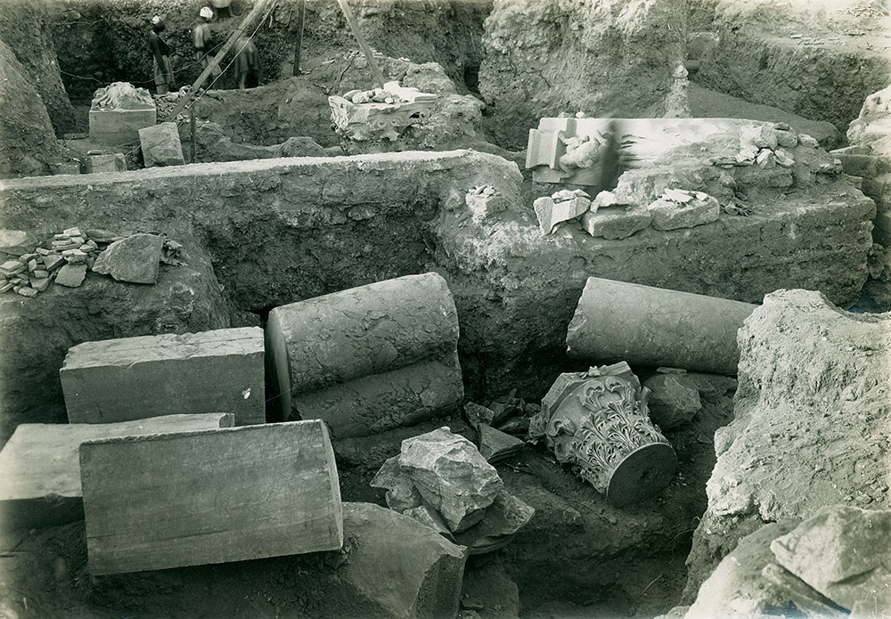 "Fig. 6. Architectural members north of bouleuterion/odeum scaena wall (PEF G319, ""Same as 93 [Architectural remains] showing foundation wall,"" 1920; courtesy Palestine Exploration Fund, London)."