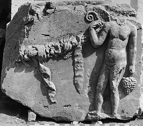 Fig. 5. Spandrel block from the Arch of Augustus with a genius and garland depicted in relief (G.R. Swain, archive photograph, 1924, no. 7.1371, Pisidian Antioch excavation archive, Kelsey Museum of Archaeology, University of Michigan; courtesy Kelsey Museum of Archaeology).