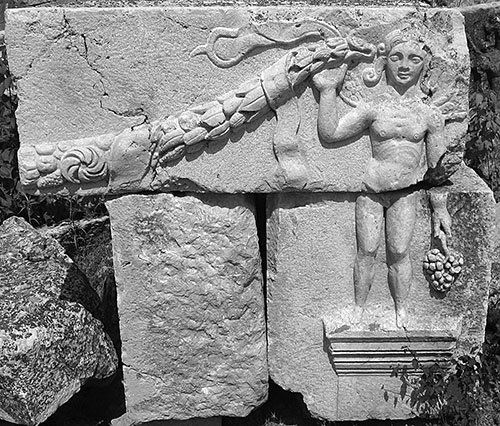 Fig. 15. Spandrel block from the Arch of Hadrian and Sabina with a genius and garland depicted in relief.