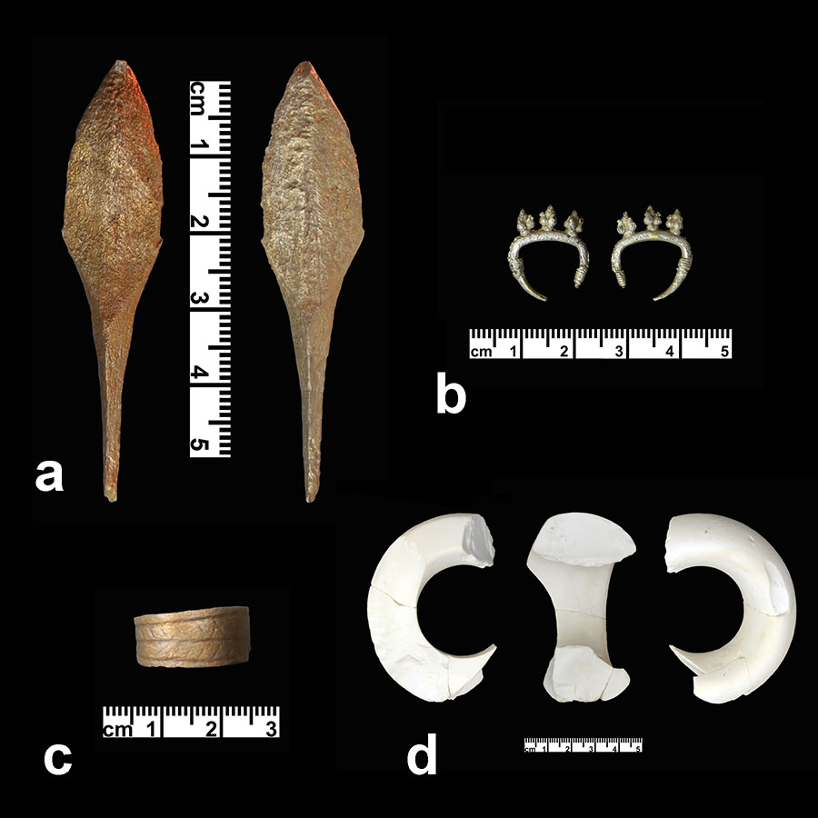 Fig. 2. Material from the Late Bronze/Early Iron Age tomb at Wisad Pools: a, bronze point; b, silver earring; c, copper  finger ring; d, macehead.