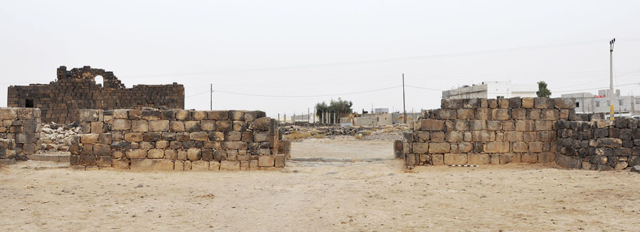 Fig. 3. The preserved remains of the Gate of Commodus as viewed from the east looking toward modern Umm el-Jimal. The West Church is visible on the left.
