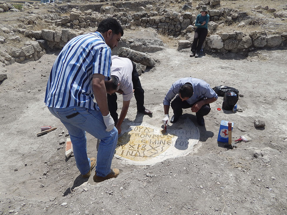 Fig. 6. Recovery of the mosaic in Area III at Tall Zira'a by experts from the Department of Antiquities of Jordan.