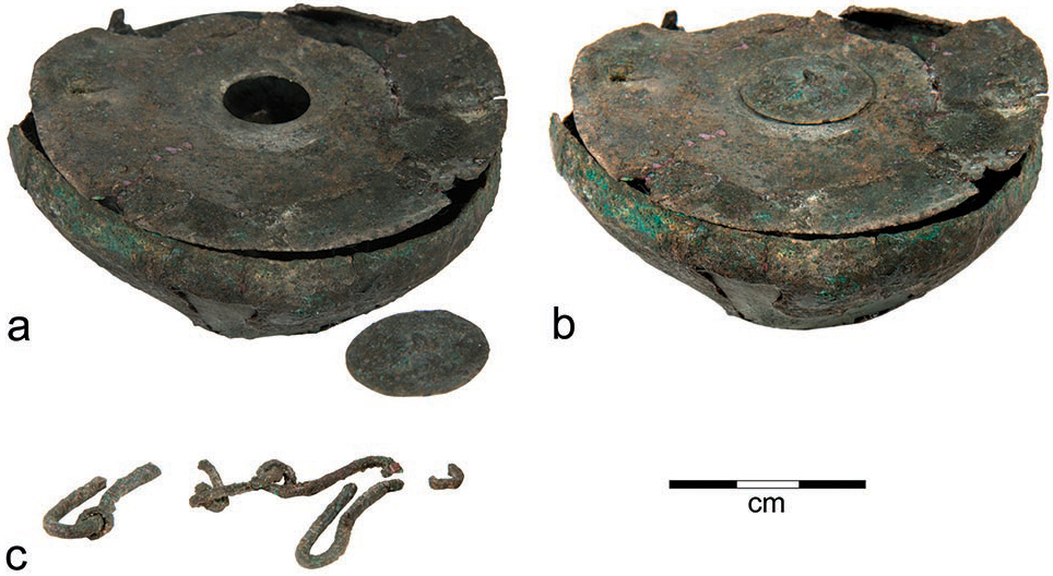 Fig. 3. Parts of a bronze inkwell from Tel Kedesh: a, bowl with small cover removed; b, bowl with small cover in place; c, fragments of a chain that probably once stretched across the top of the lid (P. Lanyi; courtesy Sharon Herbert and An­drea Berlin, Tel Kedesh Excavations)