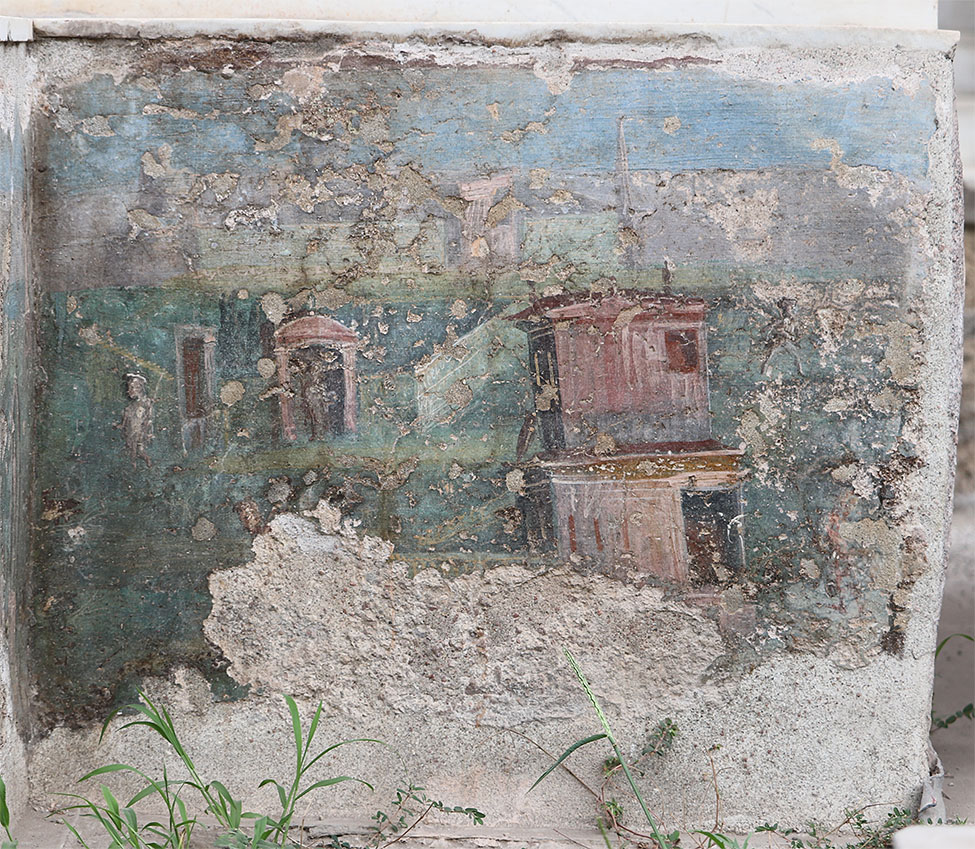 Fig. 10. Interior face of the eastern side of the southern bench of the Casa dell'Efebo water triclinium. Visible features include those labeled on print-published fig. 9, top, with the exception of the now mostly destroyed D and F.