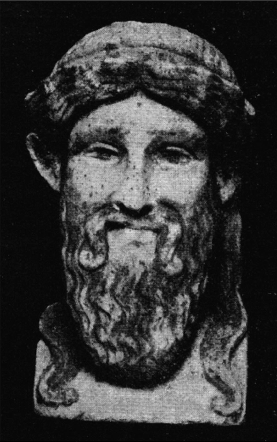 Fig. 20. Head of a marble herm, ht. 0.19 m, once part of a fence dividing the eastern and western sides of the Casa dell'Efebo garden. Some paint preserved (yellow on hair, mustache, and beard; black on eyebrows and pupils; red on fillet). The statuette is no. 4145 in the inventories from the excavations at Pompeii (after Maiuri 1927, fig. 37; courtesy Accademia Nazionale dei Lincei).