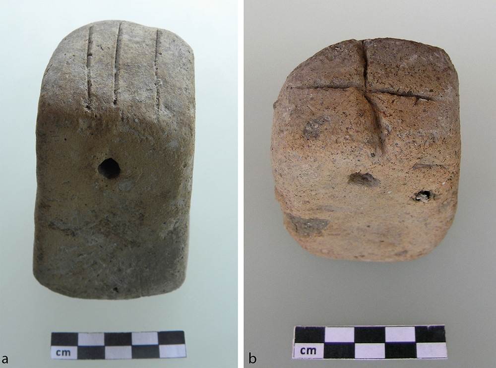 Fig. 16. Loomweights with incised patterns: <em>a</em>, HM22810, from cobbled layer between Terraced Building Phases 1 and 2; <em>b</em>, HM27135, from surface cleaning on the south rim (now in the Elmalı Museum).