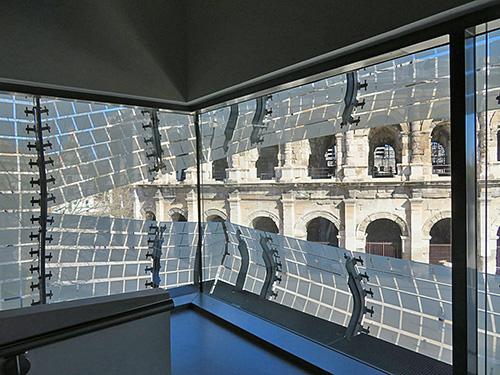 Fig. 2. View of the Roman amphitheater, as seen from inside the Musée de la Romanité, Nîmes.