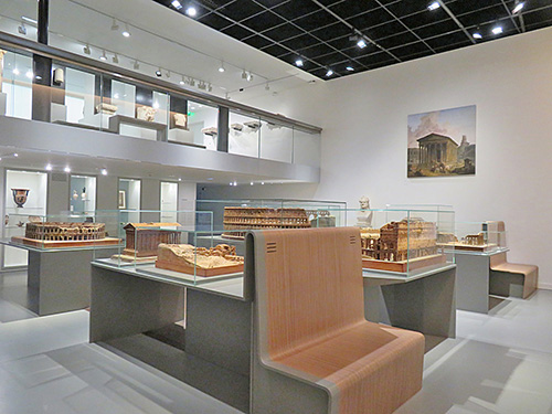 Fig. 5. View of the Legacy of Roman Antiquity gallery with architectural models by Auguste Pelet, and Medieval Period mezzanine above. Musée de la Romanité, Nîmes.