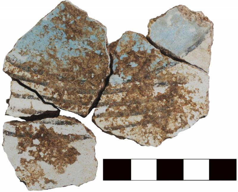 Fig. 4. Joining fragments (3055–15a, 3055–16f) of painted wall fresco, with blue, white, and black decoration, from area D-South.