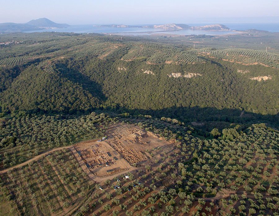 Fig. 1. Aerial view of the Iklaina plateau looking west. The bay of Navarino can be seen in the distance.