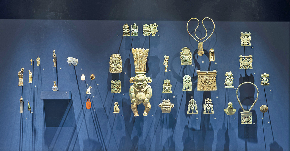 "Fig. 3. Faience plaques and other jewelry as displayed in ""Ancient Nubia Now,"" Napatan period, 750–650 BCE, excavated at El-Kurru. Boston, Museum of Fine Arts, Ann and Graham Gund Gallery (© Museum of Fine Arts, Boston)."