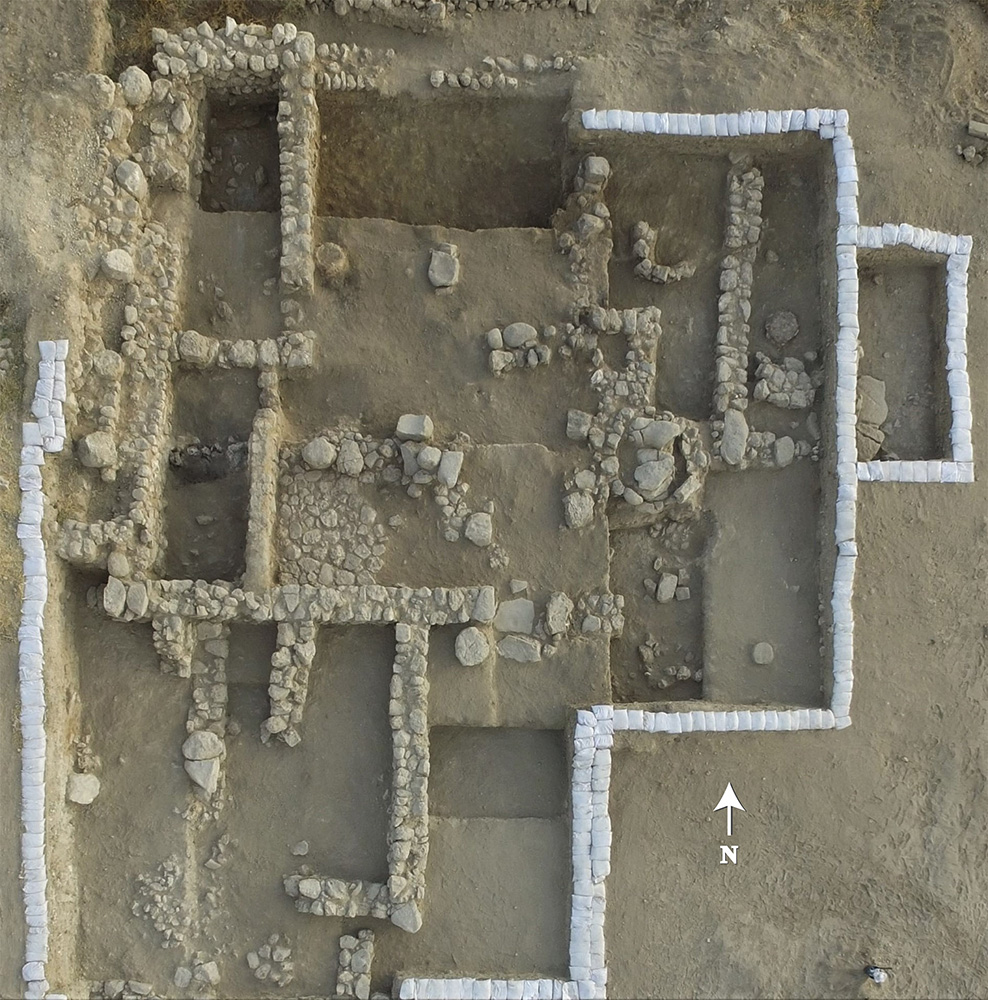 Fig. 6. Aerial view of the Level VI North-East Temple in Area BB. White sandbags secure the balks (E. Aladjem, Israel Antiquities Authority).