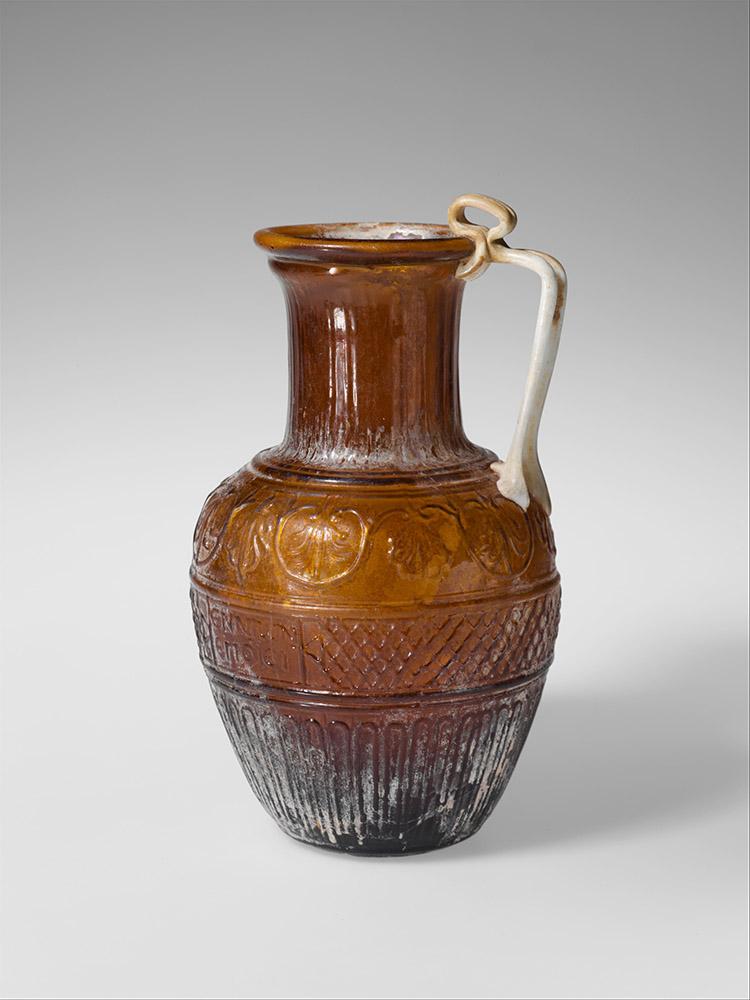 Fig. 2. Glass jug by Ennion, Roman, first half of first century CE, ht. 18.4 cm. New York, Metropolitan Museum of Art 17.194.226, acq. 1917, gift of J. Pierpont Morgan (courtesy Metropolitan Museum of Art).