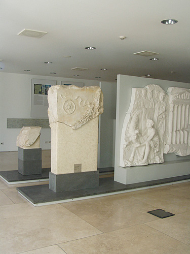 Fig. 4. Installation view of basement gallery with original marble fragments and plaster casts of reliefs from a Claudian Roman altar, mid first century C.E. (courtesy Sovraintendenza ai Beni Culturali del Comune di Roma).
