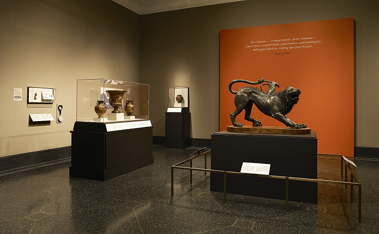 Fig. 1. Installation view of the exhibition: right, the Chimaera of Arezzo; left, cases with ancient vases, gems, and finger rings (E.M. Rosenbery).