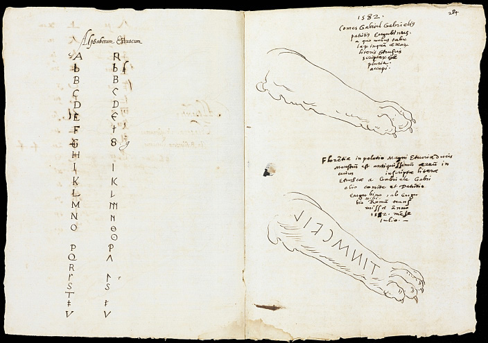 Fig. 5. Manuscript with pen and ink drawings by Alfonso Chacón (1540–1599): facing page, Latin and Etruscan alphabets; recto, right foreleg of the Chimaera of Arezzo with retrograde Etruscan inscription, 28 x 41 cm, 1582. Los Angeles, Research Library, the Getty Research Institute, inv. no. 840005B.