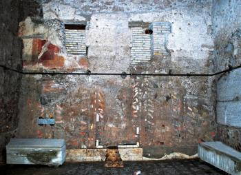 Northern wall of Room A with tuff piers visible behind later decorative elements.