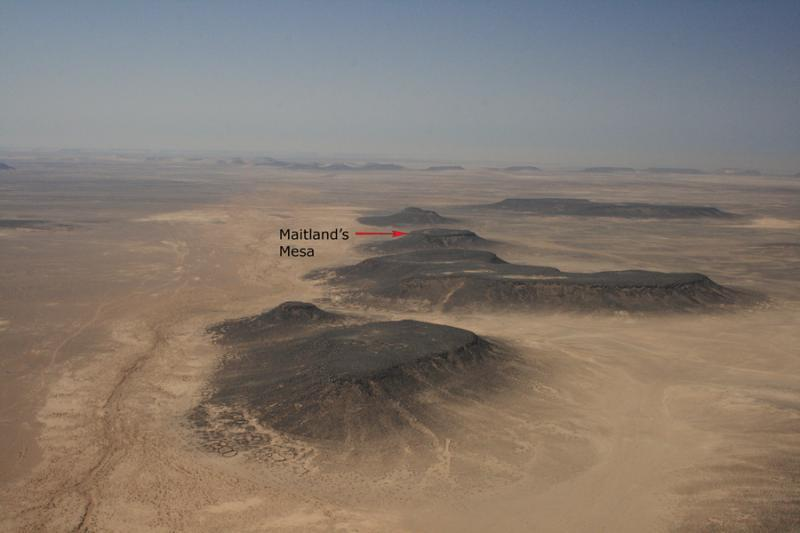Fig. 32. Area of basalt-capped plateaus along Wadi al-Qattafi, looking south toward Maitland's Mesa (I. Ruben).