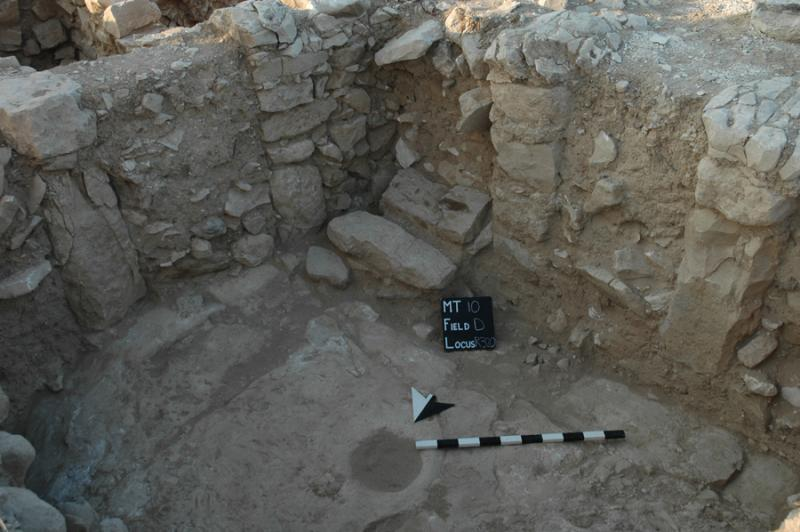 Fig. 49. View of the central hall of Building 306, Khirbat al-Mudayna, facing southeast, showing pillars, doorways, and the foot of a staircase to an unpreserved upper story (courtesy Wadi ath-Thamad Project).