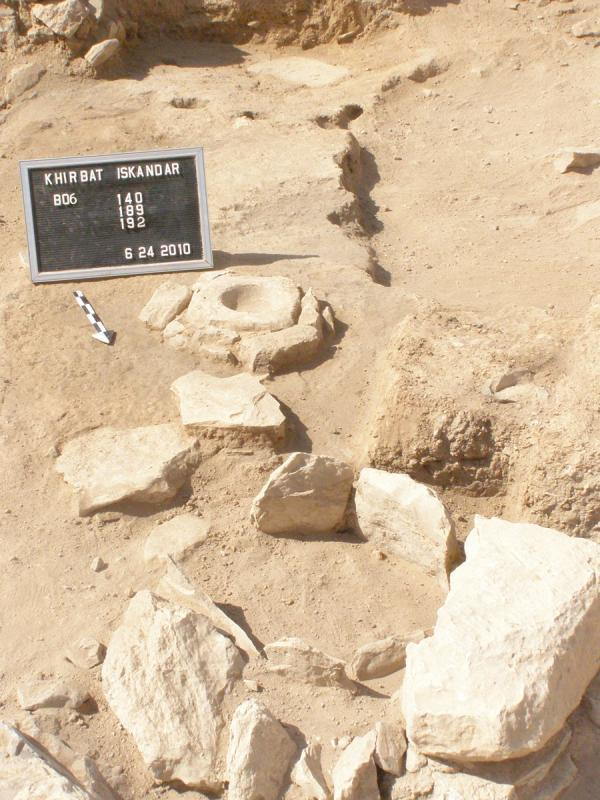 Fig. 50. The square B6 courtyard at Khirbat Iskandar with bin, mortar, and postholes (G. Kochheiser).