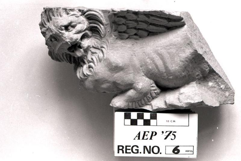 "Fig. 74. Fragment of a ""winged lion"" from a capital on one of the columns around the podium in the cella of a temple in Petra. Original photograph from the American Expedition to Petra artifact registries (courtesy the American Center of Oriental Research and the Department of Antiquities of Jordan)."