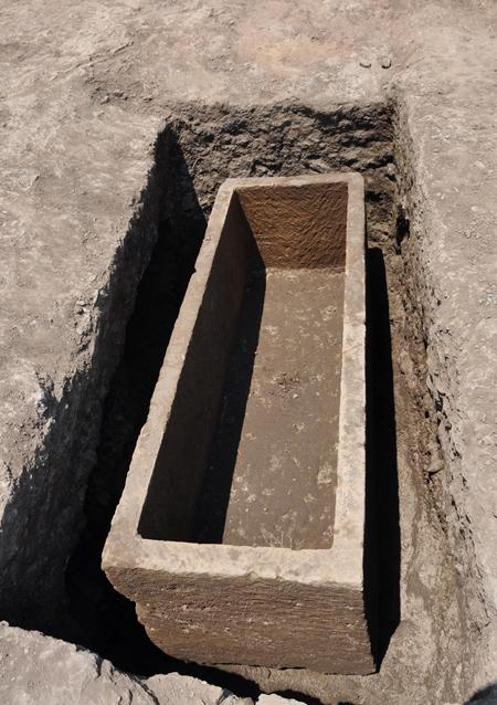 Fig. 2. Gabii, Area D, Tomb 25, view of tuff sarcophagus after removal of the human remains found inside it and of the fill of the tomb around it, from the south.