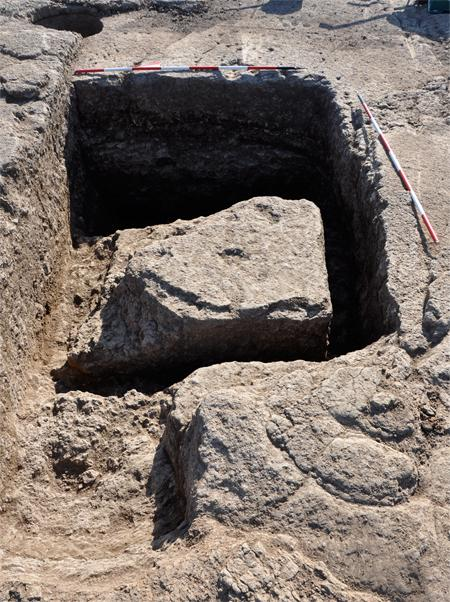 Fig. 4. Gabii, Area A, view of an assay pit dug in the bedrock south of the large quarry, from the west. Note the almost completely carved block, which was left on the bottom of the pit after being damaged.