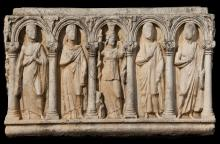 "Columnar sarcophagus from Aphrodisias (S-7) with five figures (from left to right): athletic youth, female portrait, ""composite"" goddess, male portrait, athletic youth (courtesy New York University, Excavations at Aphrodisias)."